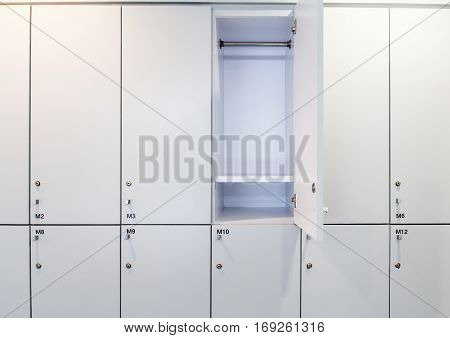 set of white closets in swimming bathroom