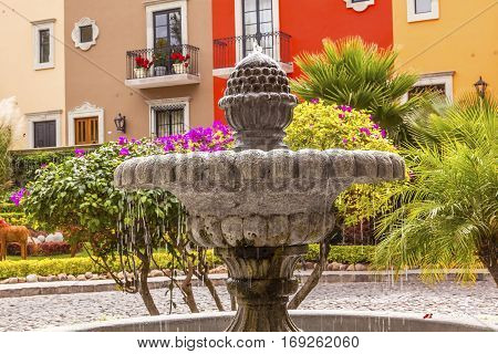 Fountain Colorful Buildings Tourists Hotels San Miguel de Allende Mexico.