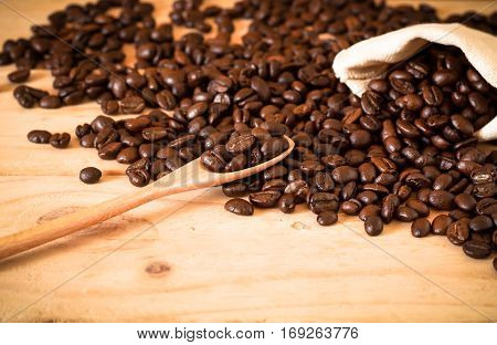The Arabica And Robusta Coffee Beans, Selective Focus At Spoon, Copy Space, Can Be Used As A Backgro