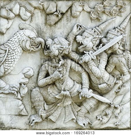 masterpiece of traditional Thai style stucco art old about Ramayana story on temple decorative wall at Wat Panan Choeng temple Ayutthaya Thailand. World Heritage Site