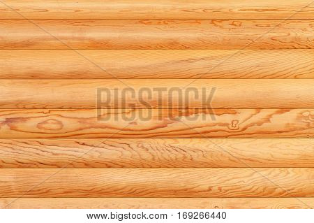Natural background from log wall. Texture of wooden logs.