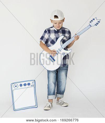 Small Kid Boy Guitarist Musician Concept