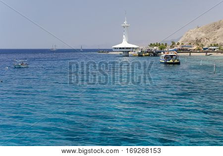 View on coral reef at southern public beach of Eilat - famous recreation and resort town on the Red Sea, Israel
