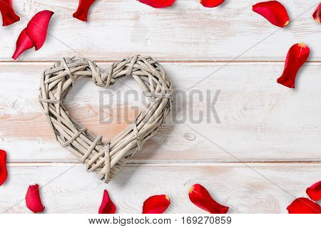 Wicker Rattan Heart With Rose Petals And Copy Space