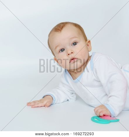 bright portrait of adorable baby teething close up