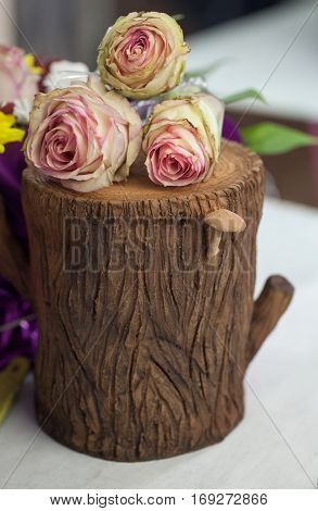 Beautiful Flowers Decoration On The Tree Stump.