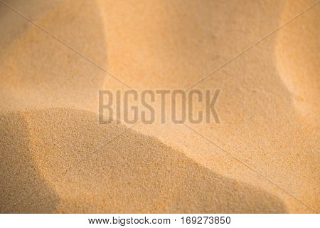 background and texture of sand pattern on a beach in summer