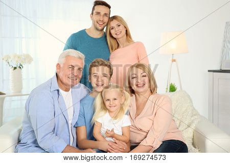 Happy family gathered in living room