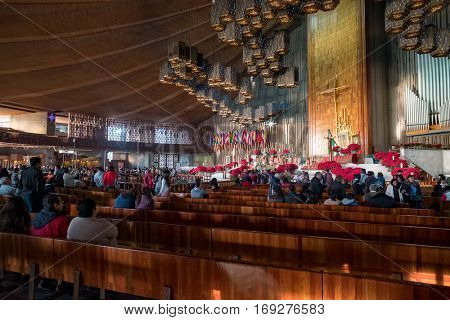 MEXICO CITY,MEXICO - DECEMBER 26,2016 : Mexicans getting ready for an early morning mass at the Basilica of Our Lady of Guadalupe in Mexico City
