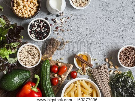 Vegetarian food background. Set of vegetarian products on the gray table top view. Healthy diet food concept. Free space