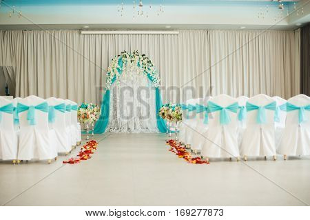 Decorated Festive Wedding Hall. A Wedding Arch For The Wedding Ceremony When The Bride And Groom. El