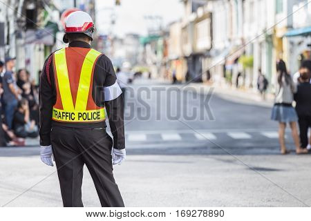 Traffic Police Standing On The Road While Doing The Work