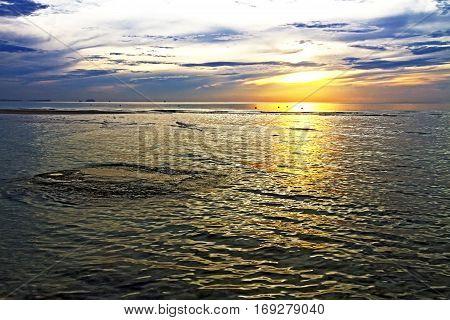 Sunrise beautyful shadow on Thung Wua Lan Beach at Chumphon Province Thailand.