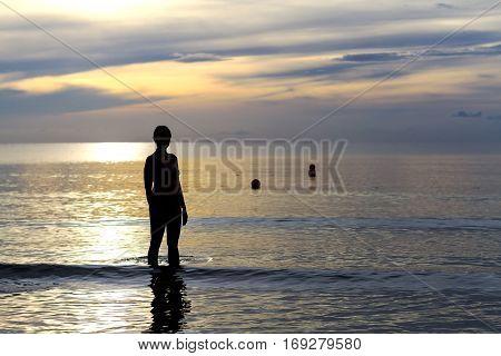 Women body silhouette sunrise on Thung Wua Lan Beach at Chumphon Provice Thailand.