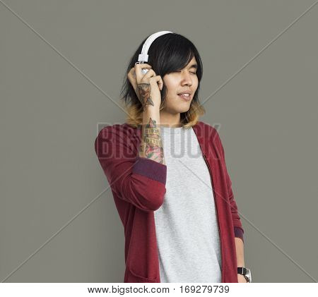 Asian Man Tattooed Arm Headphones