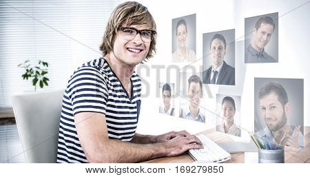 Profile pictures against creative businessman at computer