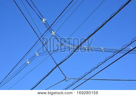 electricity transmission pylon against blue sky .