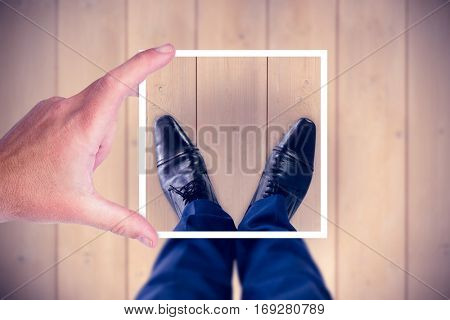 Composite image of hand holding polaroid picture