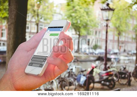 hand holding smartphone against smartphone text messaging