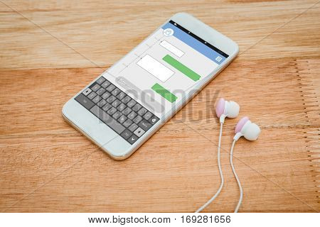 Smartphone text messaging against white smartphone with white headphones