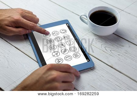 Telephone apps icons against person using tablet on wooden table