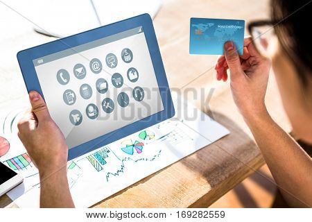 Telephone with apps icon against cropped image of hipster businessman using tablet and credit card
