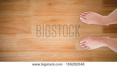 Feet against wooden flooring