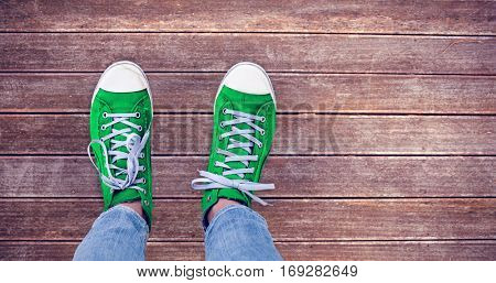Casual shoes against wooden planks background