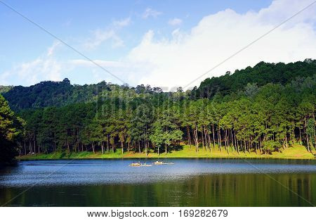 Bamboo raft floating in clear water in the morning at Pang Oung Lake (Pang Tong reservoir) Mae hong son Thailand.