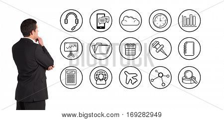 Businessman standing and looking against telephone apps icons