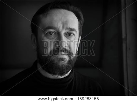 Black and white portrait of a bearded middle-aged men
