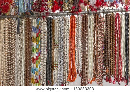 closeup of various style bead necklace display in shopfront in Pushkar city rajasthan India