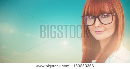 Portrait of a smiling hipster woman against blue green background