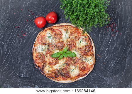 Pizza with Ham on dark background