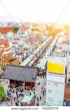 Business and culture concept - panoramic modern city skyline bird eye aerial view with Sensoji-ji Temple shrine - Asakusa district under dramatic sunrise and morning blue sky in Tokyo Japan. Miniature Tilt-shift effect