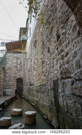 Historic Siloam Pool in Jerusalem Herodian road Israel .