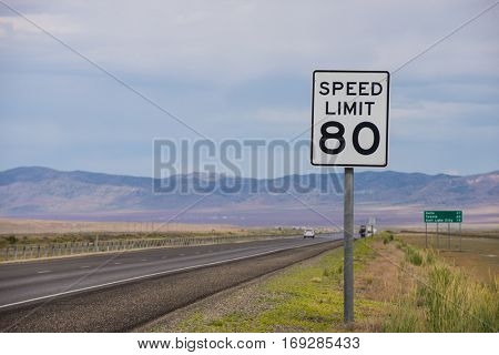 Speed Limit 80 sign on side of interstate highway