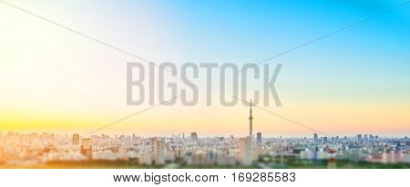 Business and culture concept - panoramic modern city skyline bird eye aerial view with tokyo skytree under dramatic sunset glow and beautiful cloudy sky in Tokyo Japan. Miniature Tilt-shift effect