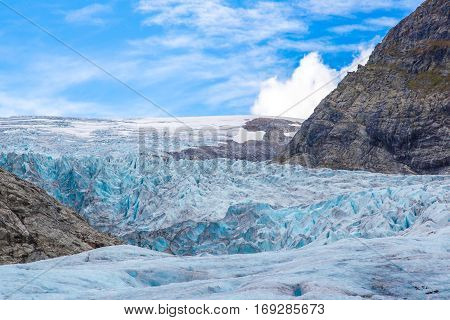 Surface of Nigardsbreen glacier Norway with blue sky