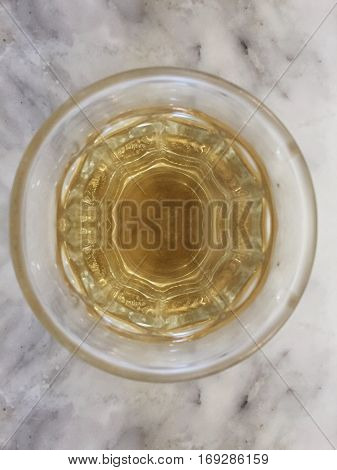 Hot Chinese tea in glass cup on marble