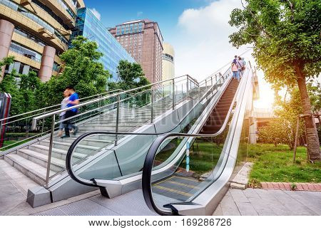 The escalator of the skyscraper building on the streets of Shanghai.