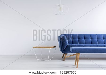 Room With Blue Sofa And Bench