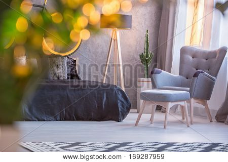 Bedroom With Armchair And Footstool