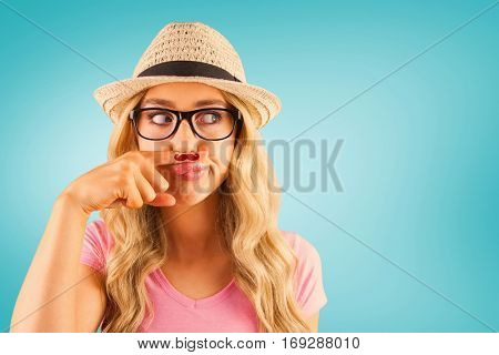 A beautiful hipster having a fake mustache against blue vignette background
