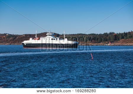 Ro-Ro ferry ship goes on Norwegian sea side view. Trondheim Norway poster