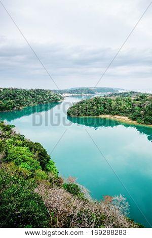Panoramic bird eye aerial view of beautiful river mirror with fantasy blue sky in Okinawa Japan