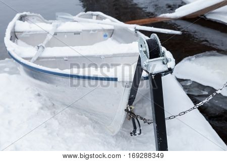 Small White Rowboat Lay On Pier