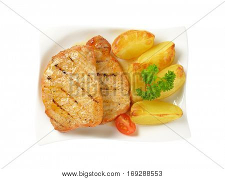 Grilled honey glazed pork chops with potato wedges