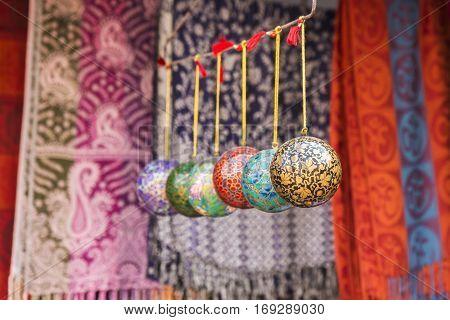 India art style ornament balls hanging display in shopfront in Pushkar rajasthan India