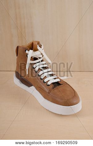 Fashion male shoes on wooden background